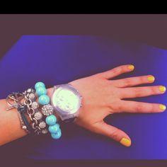 My weekend wrist stack. Zoya Creamy polish, Swatch silver Full Blooded, bloomingdales aqua bead bracelet, Tiffany & Co. large heart bracelet, random bracelets