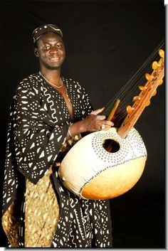 Mandinka man playing the kora