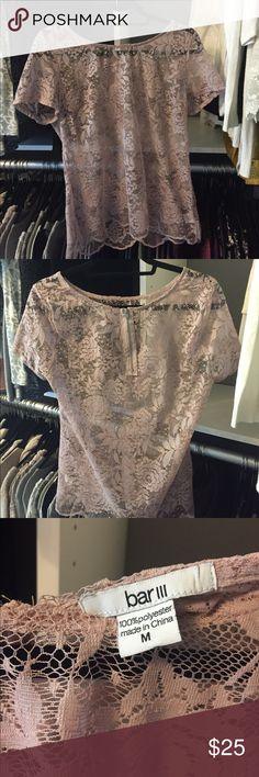Pink lace top, size medium Such a beautiful shirt from bar III. Light pink and lace with a zipper in the back! This shirt can be worn to work, dressed up, casual and looks great with dark denim or tucked into a skirt. This shirt is in excellent condition. This item comes from a pet free and smoke free home. Tops Tees - Short Sleeve