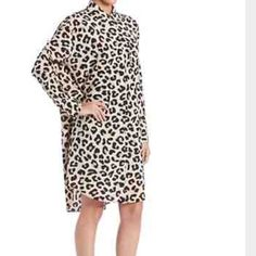 DKNY leopard print shirt dress Beige and black silk blend leopard print shirt dress from DKNY featuring a classic collar, a concealed front fastening, long sleeves, button cuffs and a curved hem. DKNY Dresses