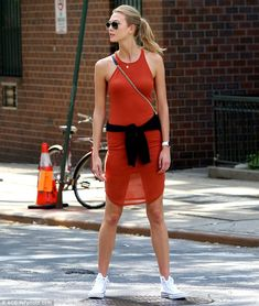 It's all about those legs:  Karly Kloss flashed her lovely long pins when the bright sunshine rendered her orange dress see-through as she stepped out in New York on Friday