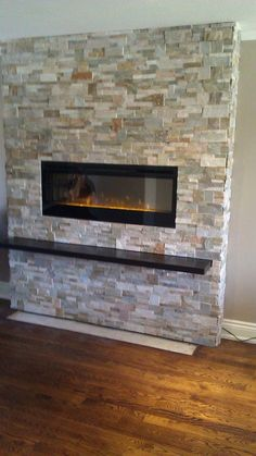 A beautiful mantel shelf below an electric fireplace for storage and design.