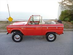 Red Ford Bronco small SUV