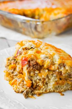 John Wayne Casserole is an easy ground beef casserole recipe with a biscuit base and loaded with diced tomatoes, corn, taco seasoning, cream cheese, mozzarella and cheddar. Mexican Cornbread Casserole, Beef Casserole Recipes, Steak Casserole, Crockpot Recipes, Farmers Casserole, Jiffy Cornbread, Goulash Recipes, Meat Recipes, Recipes