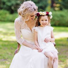 We just love this little boho flower girl dress with Chelsea! Elegance with a little playful mixed in!