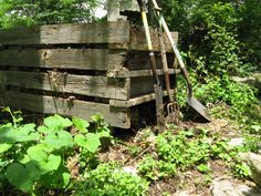 DIY compost bin. I love the look of this one. The old barn boards are very cool.