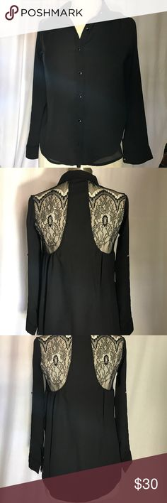 Black blouse with beautiful detail in the back Beautiful black blouse with black buttons with silver outline. Has a button on each arm if you want to roll up the sleeves. Back detail beautiful lace😍  No tags & never been worn. Monteau Tops Blouses