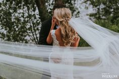 What an amazing veil! The photographer captures the movement in this fabulous photo From WedLuxe Magazine #veil #wedding #weddingphotography #photography #wedluxe