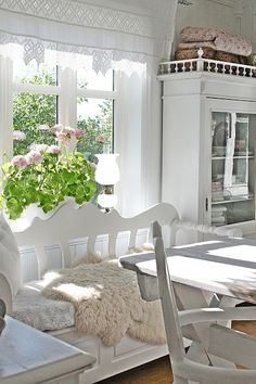 love the light, the inside greenery, the cosy sheepskin, and a nice big practical table - good workspace