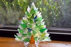 Sea Glass Tree: ~ craft project submitted byKelly Thaden   I start this tree with a piece of lucite shaped like a Christmas tree, then I use clear, flat sea glass