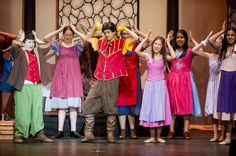 """Weaver seventh-grader Robert Davey, center, flexes while playing the role of Gaston during the Weaver Performing Arts production of """"Beauty and the Beast Jr."""" at the Merced Theatre in Merced, Calif., Tuesday, March 1, 2016. Cast and crew for the production consists of over 60 students from all three schools in the Weaver Union School District."""