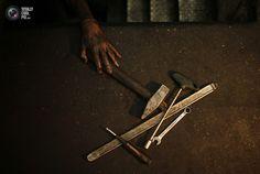 The hand of Palestinian Jundeya is seen as he works in a car repair garage in Gaza City. MOHAMMED SALEM/REUTERS