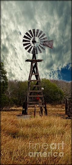 Face The Wind - Windmill Photography Art by Ella Kaye.   This image was captured in farmland outside Victoria, Texas.   Windmills are the most efficient way for ranchers to pump water for their livestock. This is an old wooden structure supporting the metal housing and blades.   Thank you for your interest in my artwork: Photography and Paintings.  (c) Ella Kaye  Texas artist