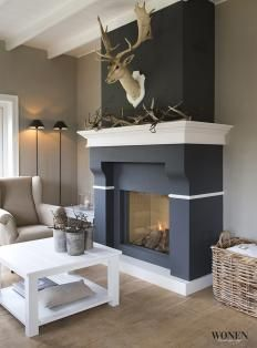 Dark Gray fireplace surrounding with white mantel and accents make this hearth area an amazing addition to any modern abode. - www.hudsonvalleychimney.com