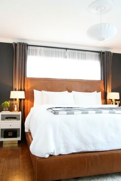 leather headboard, white nightstands, swing arm lamps