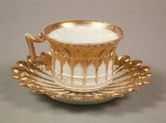 Meissen Style Cup & Saucer in White and Gold.