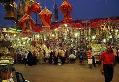 In this Sunday, June 15, 2014 photo, Egyptians shop for traditional lanterns used for the holy month of Ramadan starting next week, at a market in the neighborhood of Sayeda Zeinab, Cairo, Egypt. Many devout Muslims in the Middle East will start observing the dawn-to-dusk fast during the holy month of Ramadan next week. (AP Photo/Ahmed Abdel Fattah, El Shorouk Newspaper)