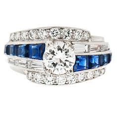 RAYMOND YARD signed Diamond & Sapphire Ring. Beautifully designed Platinum Handmade signed Raymond Yard Ring. The center diamond weighs approximately .62 of a carat which is offset with 8 square sapphires along with 8 baguette diamonds and 18 round diamonds. Circa 1970s-1980s