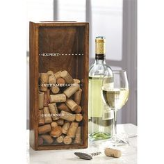 "The Cork Collector Box by Mud Pie is a wood and glass cork catcher box for wine corks with an easy drop slot on top to showcase a wine enthusiast's cork collection. The Wine Cork Collector Box features ""Beginner,"" ""Intermediate"" and ""Expert"" level lines."