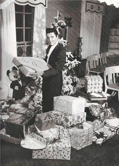 "takingcare-of-business: ""Elvis Presley spending Christmas home at Graceland, December, 1957. """