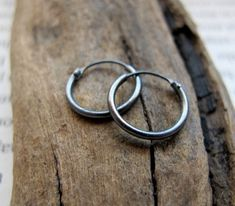 Small Dark Silver Hoop Earrings for Men - Unisex Black Hoops - Sterling Silver Huggie Earrings 10mm, 12mm, 15mm - Elegant / Modern Jewelry by NadinArtDesign on Etsy https://www.etsy.com/listing/116593304/small-dark-silver-hoop-earrings-for-men