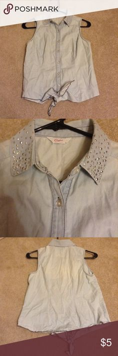Chambray Shirt Candies chambray shirt with a studded collar. It looks like a denim but it's more of a chambray material. Candies is a brand sold at kohls in the juniors department so the sizing isn't the exact same as women's. The tags cut off so I don't know the exact size but it would probably fit most people who are a size medium or large. You can also tie up the bottom of it. Candie's Tops