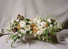 """""""This floral centerpiece by @loopflowers is filled with #ranunculus, combo #roses, sweet pea, #fritillaria, #hyacinth, spirea and bunny grass. See more of…"""""""