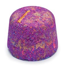 LUSH Phoenix Rising bath bomb. Has a cinnamon and apple fragrance.
