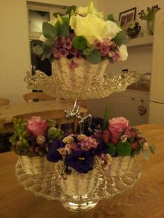 Vintage glass cake stands can be stacked one on top of each to create tiers. Use to display cup cakes or flowers. To hire, go to, www.porterandsmith.co.uk