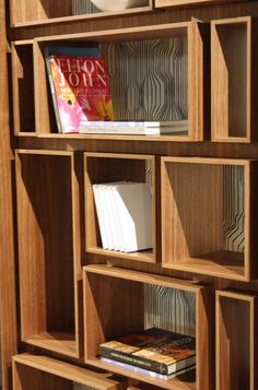 Add to ideabook by Holly Marder by Holly Marder  This is another shelving display at the Porada booth, First, designed by Gino Carollo.     This fuss-free product features inset boxes for books, magazines and accessories. The robust design is made with smooth canaletto walnut and a laminated stainless steel base.