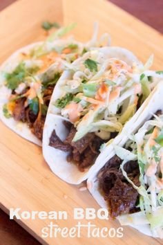 Korean BBQ Street Tacos. Made in the slow cooker and topped with the most amazing asian slaw! Easy weeknight dinner in the crockpot. #dinner #recipe #korean #BBQ #tacos #love #delicious #DELİCİOUSFOOD