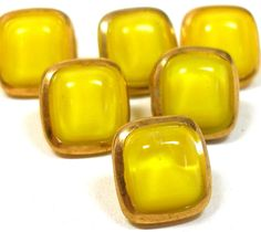 50s Glass buttons, 6 yellow & gold moonglow German buttons.