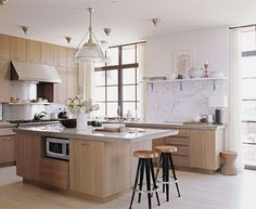 A different take on things...Cerused oak Cabinetry would pair beautifully with the white oak flooring that you like