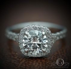 Platinum engagement ring with a Round brilliant Center stone G-VVS 1..30 with a Cushion Halo, split shank.
