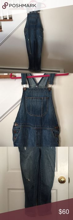 """Loft overalls  This is in great condition!! Wore this maybe twice. Really soft denim. Cute distressed look. Five pockets, two front and two in the back, one front chest pocket. Adjustable straps. Three buttons on each hip. Kind of tricky doing measurements for this.inseam unrolled is about 27"""". Looking at the waist/hip area. The measurement across the top buttons around the hip is 16.5"""". These are a looser fit. Great trend  and perfect addition to your closet.  LOFT Jeans Overalls"""