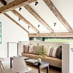 Love the exposed wood beams. Designed by Kathleen Walsh Interiors   Architectural Digest