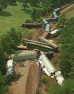 8/5/01--Twenty railroad cars belonging to the Burlington Northern Railroad derailed at about 3:30 a.m. Sunday morning in Magnolia, TX.  Three of the cars contained chemicals that are considered corrosive.  The engineer and conductor were the only people on board and neither were injured.