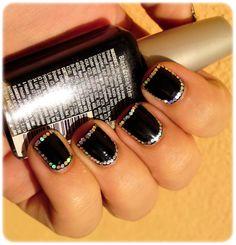 Glitter around a black nail.