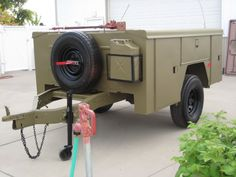 Great use of a truck service body converted into an off road trailer/camper