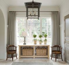 This is what I am envisioning for a console table in the family room. Baskets to store toys & games