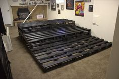 DIY Pallet Home Theater | 99 Pallets. My husband hates going to the theater and I absolutely love it. This would be a good compromise.