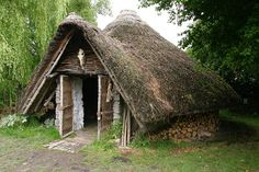 Iron Age house at Westhay    Reconstruction of an Iron Age house at the Peat Moors Centre, Westhay. The house is based on one found at the nearby Glastonbury Lake Village.