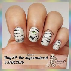 Day 29 - inspired by the supernatural #31dc2016 --------------------- - - - -  I chose a mummy,  but didn't want a grouchy mummy because that is a little too close to home.. Slap a smile on that dried up on fart! --------------------------- - - - - -  Used #LAGIRL - blackout ,  #essence - wild white ways ,  #beautyvalue -  92, #tiptop -  jitterbug lime. 💅💅💅💅💅💅💅💅 All artwork was done freehand. 😊😊😊😊😊😊😊😊😆😆😆😆 #mahnails #nailsoftheday #nailart  #nails #glitter #challenge…