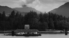 Boat Gas - The Vancouver Harbour Chevron station with Stanley Park (and beyond) in the background.