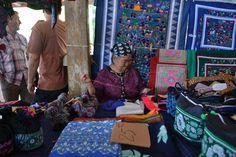 A French Guiana women sewing dresses.