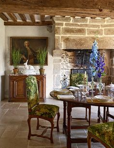Oscar de la Renta's artistic director, Peter Copping, uses his Normandy vacation home as a classic pied-à-terre. In the dining room, an 18th-century portrait attributed to the circle of Jean-Baptiste Oudry hangs above a buffet de chasse of the same period   archdigest.com