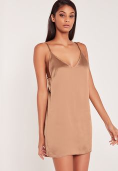 Carli Bybel x Missguided is the collaboration we've all been waiting for, from the ultimate fashion and beauty blogging queen.   Slip into something super sexy this season with this dusky pink cami dress! In a luxe silky material, adjus...