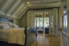 A cozy bedroom with its own on-suite living area. Coldwell Banker