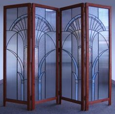 Chuck Franklin Glass Studio in Portland Oregon – Art deco design is incorporated into this four piece leaded glass room divider.