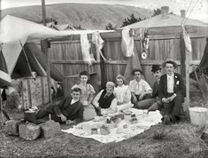 "New Zealand circa 1905. ""Unidentified group having a picnic outside tent in backyard of house, probably Christchurch district."" Are New Zeal..."